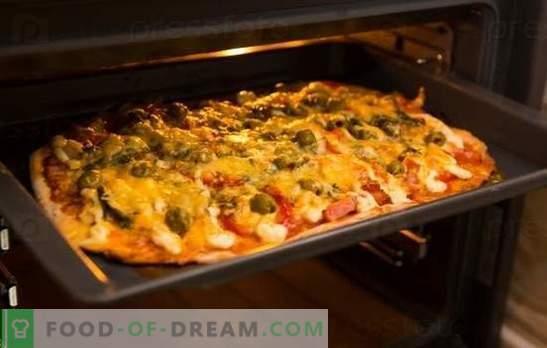 Рецептот за пица во рерната е омилено јадење дома. Пица рецепти во рерна: со сирење, печурки, шунка, морска храна